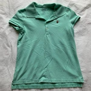 Short sleeve polo can fit an xs